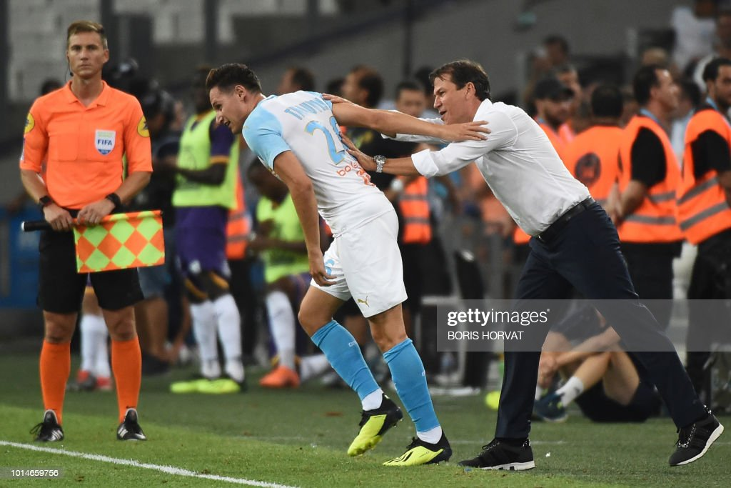 Olympique de Marseille's French midfielder Florian Thauvin (L) is congratulated by Olympique de Marseille's French head coach Rudi Garcia (R) after scoring a goal during the French L1 football match between Olympique de Marseille (OM) and Toulouse at the Velodrome stadium, in Marseille, on August 10, 2018.