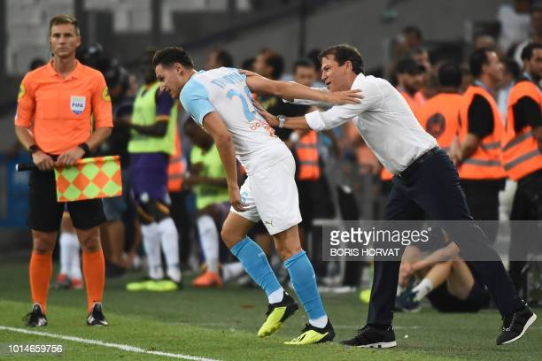 Olympique de Marseille's French midfielder Florian Thauvin is congratulated by Olympique de Marseille's French head coach Rudi Garcia after scoring a...