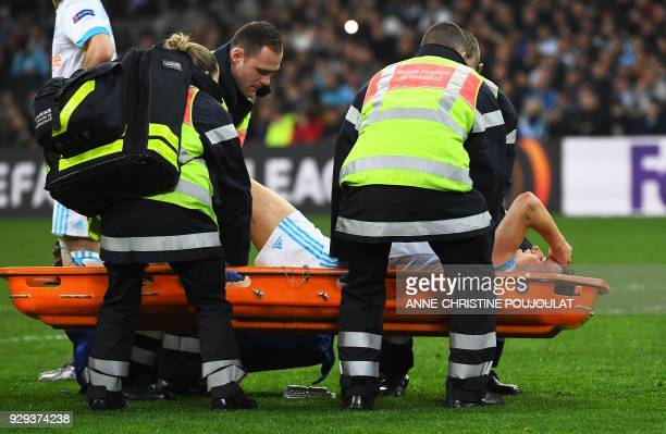 Olympique de Marseille's French midfielder Florian Thauvin leaves on a stretcher after being injured during the UEFA Europa League football match...
