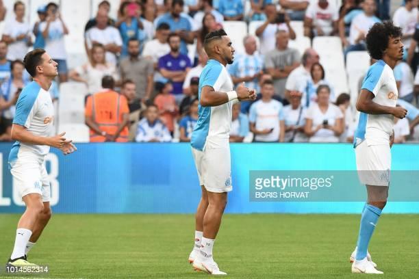Olympique de Marseille's French midfielder Florian Thauvin Olympique de Marseille's French forward Dimitri Payet and Olympique Marseille's Brazilian...