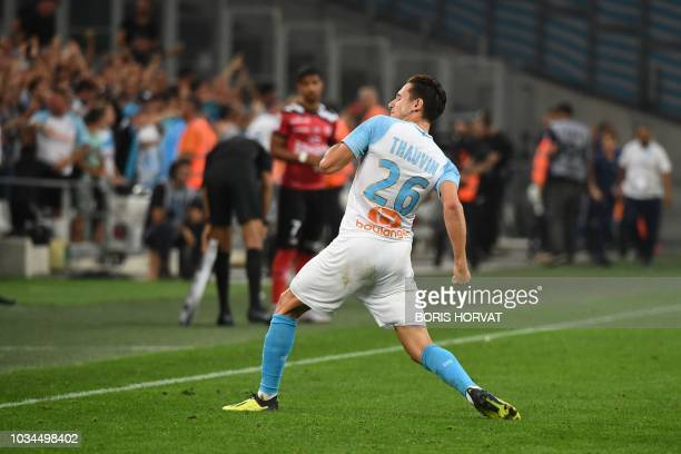 Olympique de Marseille's French midfielder Florian Thauvin reacts after scoring during their French L1 football match Olympique of Marseille versus...