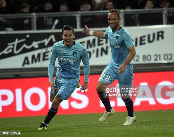 Olympique de Marseille's French midfielder Florian Thauvin reacts after scoring during the French Ligue 1 football match between Amiens and Marseille...