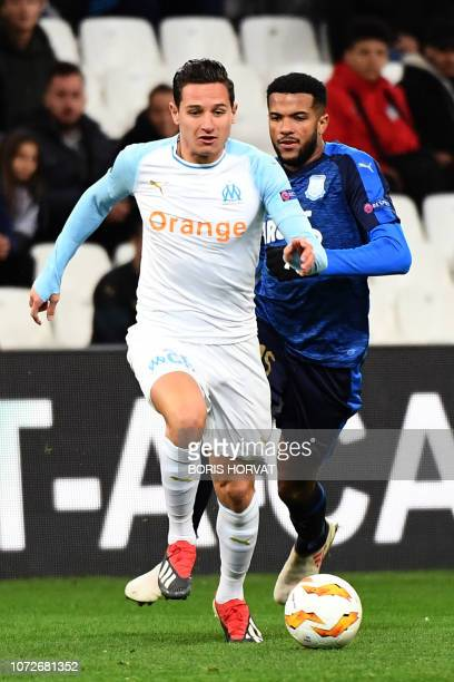 Olympique de Marseille's French midfielder Florian Thauvin runs for the ball during the UEFA Europa League Group H football match between Olympique...