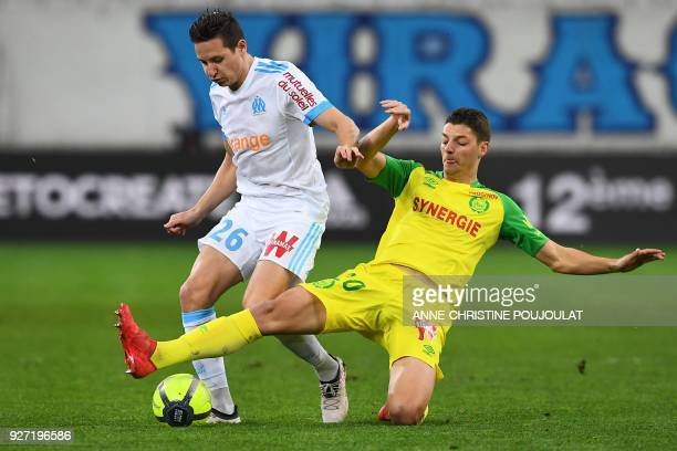 Olympique de Marseille's French midfielder Florian Thauvin vies with Nantes' Brazilian midfielder Andrei Girotto on March 04 2018 at the Velodrome...