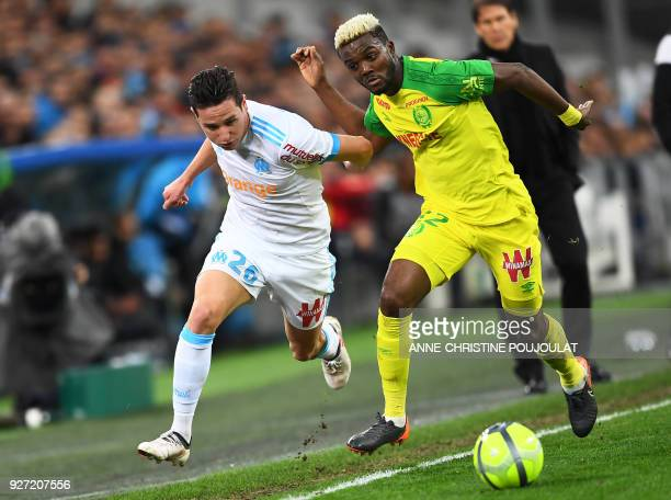 Olympique de Marseille's French midfielder Florian Thauvin vies with Nantes' Nigerian defender Chidozie Awaziem on March 04 2018 at the Velodrome...