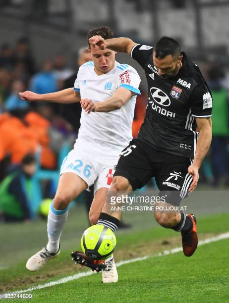 Olympique de Marseille's French midfielder Florian Thauvin vies with Lyon's French defender Jeremy Morel during the French L1 football match...