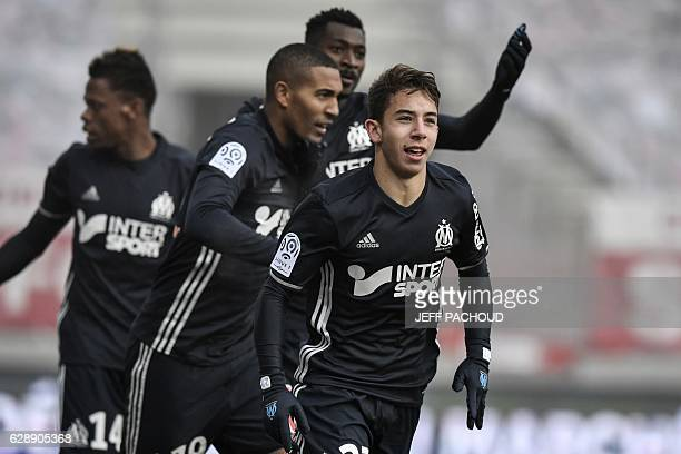 Olympique de Marseille's French midfielder Maxime Lopez celebrates after scoring a goal during the French L1 football match Dijon vs Marseille on...