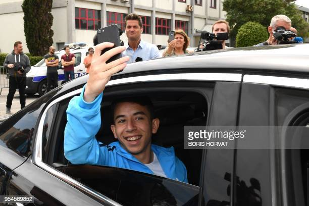 Olympique de Marseille's French midfielder Maxime Lopez gestures to the supporters as he leaves the Marignane airport after their qualification for...