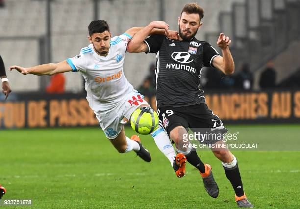TOPSHOT Olympique de Marseille's French midfielder Morgan Sanson vies with Lyon's French midfielder Lucas Tousart during the French L1 football match...