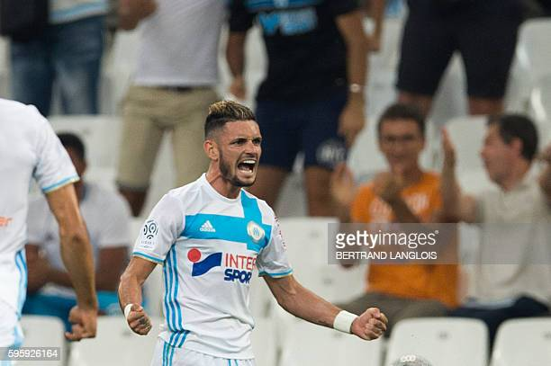 Olympique de Marseille's French midfielder Remy Cabella celebrates after scoring during the French Ligue 1 football match Olympique de Marseille...
