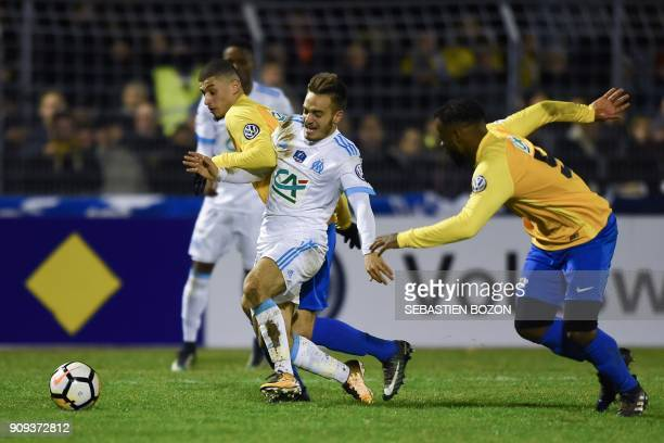 Olympique de Marseille's French midfielder Yusuf Sari vies with Epinal's French forward Driss Trichard and Epinal's Angolan defender Jeremias Tango...