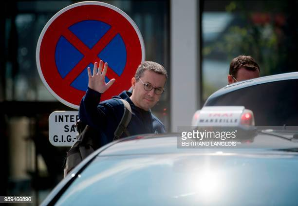 Olympique de Marseille's French president JacquesHenri Eyraud leaves the MarseilleProvence airport in Marignane southern France on May 17 2018 a day...