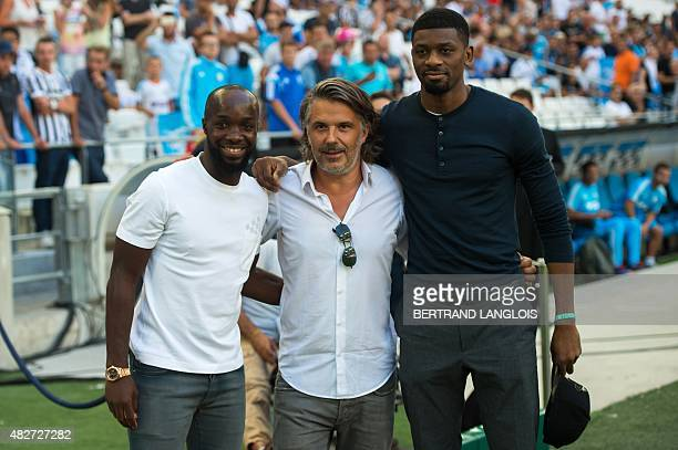Olympique de Marseille's French president Vincent Labrune poses with new players French Lassana Diarra and Abou Diaby prior to the Robert...