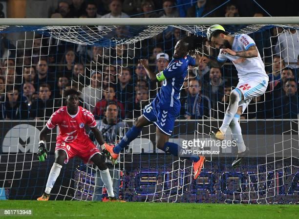 Olympique de Marseille's Greek forward Konstantinos Mitroglou vies with Strasbourg's Burkinabe defender Bakary Kone as Strasbourg's French goalkeeper...