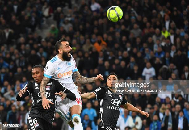 Olympique de Marseille's Greek forward Konstantinos Mitroglou vies with Lyon's Brazilian defender Marcelo during the French L1 football match...