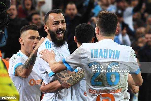Olympique de Marseille's Greek forward Konstantinos Mitroglou celebrates with teammates after scoring a goal during the French L1 football match...