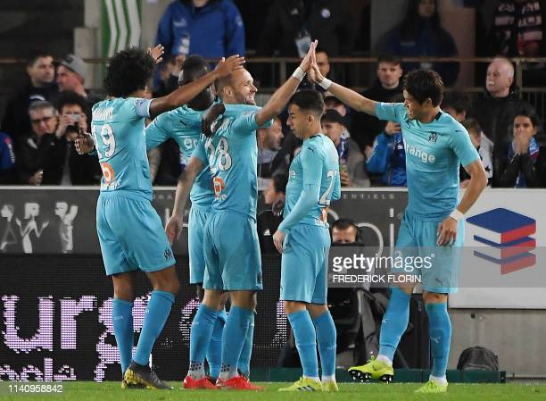 Olympique de Marseille's Japanese defender Hiroki Sakai celebrates with teammates after scoring a goal during the French L1 football match between...