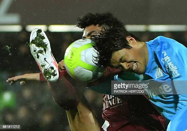 Olympique de Marseille's Japanese defender Hiroki Sakai fights for the ball with Metz's French defender Jonathan Rivierez during the French Ligue 1...