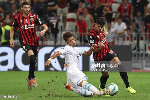 Olympique de Marseille's Japanese defender Hiroki Sakai vies with Nice's Algerian defender Youcef Atal during the French L1 football match between...