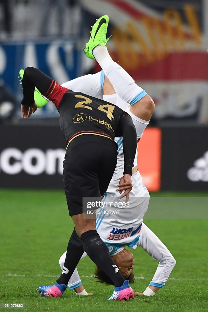 TOPSHOT - Olympique de Marseille's Japanese defender Hiroki Sakai (R) vies with Guingamp's French defender Franck Hery (L) during the French Ligue 1 football match between Olympique de Marseille (OM) and Guingamp at the Velodrome stadium in Marseille on February 8, 2017. /