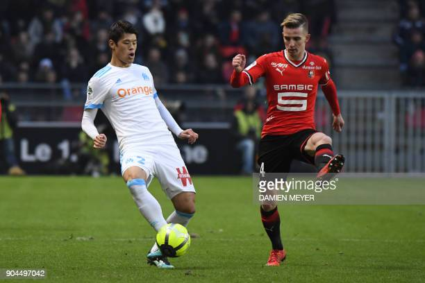 Olympique de Marseille's Japanese defender Hiroki Sakai vies with Rennes' French midfielder Benjamin Bourigeaud during the French L1 football match...