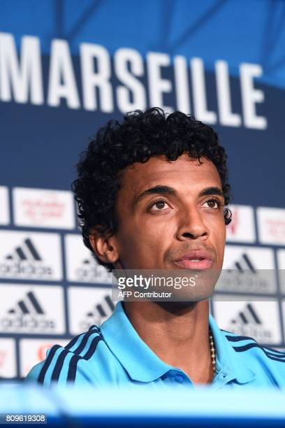 Olympique de Marseille's new Brazilian midfielder Luiz Gustavo speaks during his presentation to the club at a press conference on July 6 in...