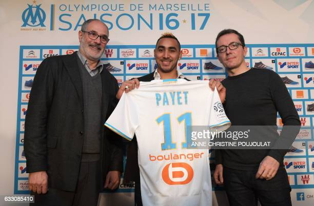 Olympique de Marseille's new forward Dimitri Payet poses with his jersey flanked by Marseille's sporting director Andoni Zubizarreta and President...