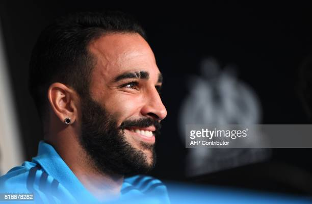 Olympique de Marseille's new French defender Adil Rami attends a press conference on July 19 in Marseille southeastern France following his transfer...