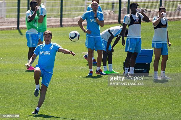 Olympique de Marseille's new Spanish head coach Jose Miguel Gonzalez Martin del Campo aka Michel kicks the ball during his first training session at...
