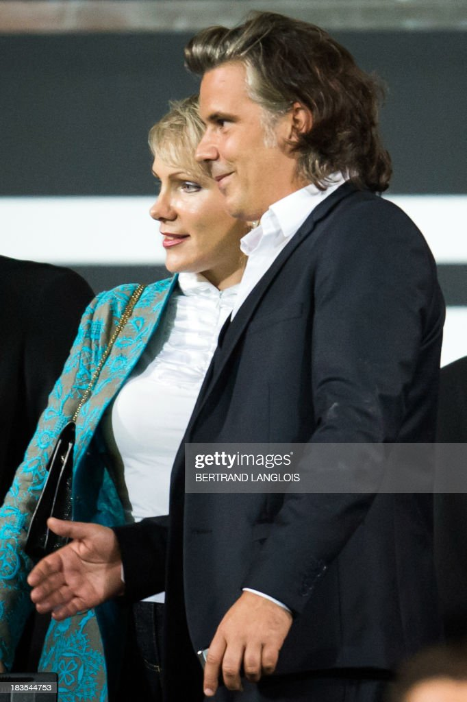 Olympique de Marseille's owner Margarita Louis-Dreyfus (L) and OM's president Vincent Labrune (R) stand prior to the French L1 football match Olympique de Marseille vs Paris Saint-Germain on October 6, 2013 at the Velodrome stadium in Marseille, southern France.