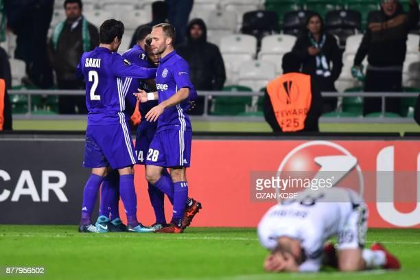 Olympique de Marseille's players celebrate after Konyaspor's Wilfried Moke scored an own goal during the UEFA Europa League Group I football match...