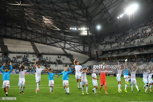 Olympique de Marseille's players celebrate at the final whistle of the French L1 football match Olympique de Marseille vs Dijon on August 6 2017 at...