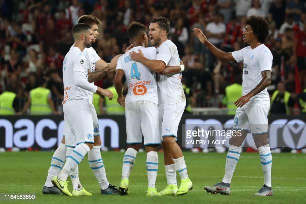 Olympique de Marseille's players celebrate their victory after the French L1 football match between OGC Nice and Olympique de Marseille on August 28...