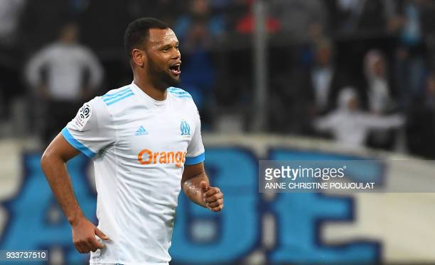 Olympique de Marseille's Portuguese defender Rolando celebrates after scoring a goal during the French L1 football match Marseille vs Lyon on March...