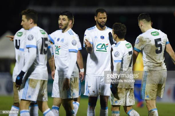 Olympique de Marseille's Portuguese defender Rolando celebrates his team's victory with teammates at the end of the French Cup football match between...