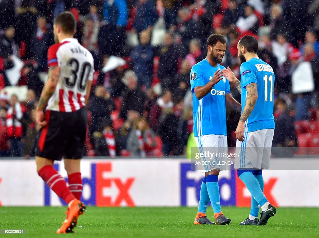Olympique de Marseille's Portuguese defender Rolando (2R) celebrates with teammate Greek forward Kostas Mitroglou at the end of the UEFA Europa League round of sixteen second leg football match between Athletic Club Bilbao and Olympique de Marseille at the San Mames stadium in Bilbao on March 15, 2018. /