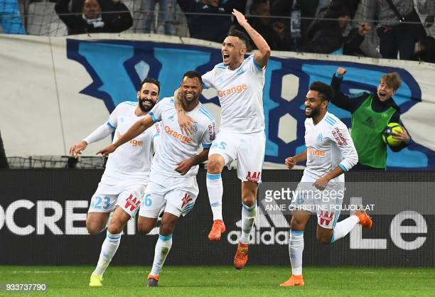 Olympique de Marseille's Portuguese defender Rolando celebrates with teammates after scoring a goal during the French L1 football match Marseille vs...