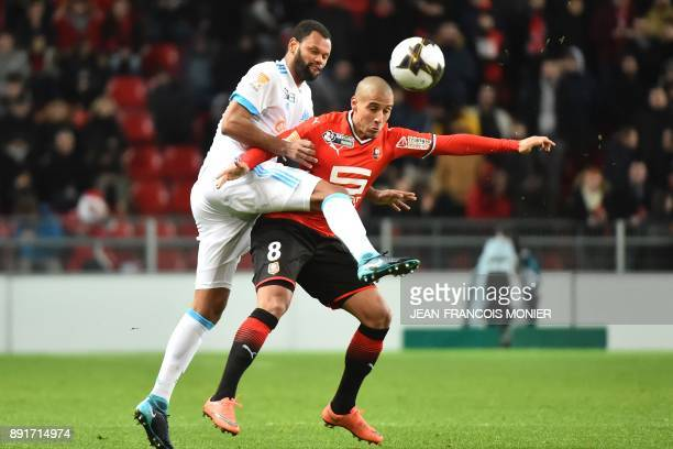 Olympique de Marseille's Portuguese defender Rolando vies with Rennes' French midfielder Wahbi Khazri during the French League Cup round of 16...