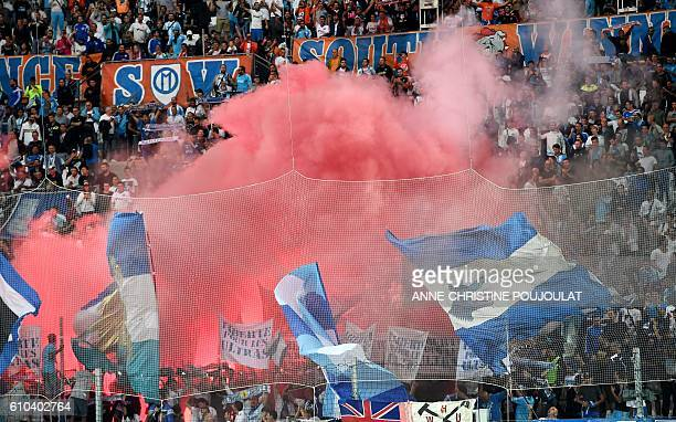 Olympique de Marseille's supporters cheer their team during the French L1 football match Marseille vs Nantes on September 25 2016 at the Velodrome...