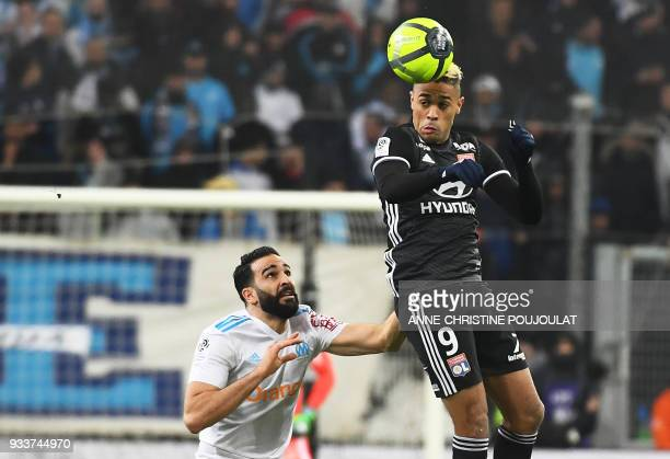 Olympique deMarseille's French defender Adil Rami vies with Lyon's Spanish forward Mariano Diaz during the French L1 football match Marseille vs Lyon...