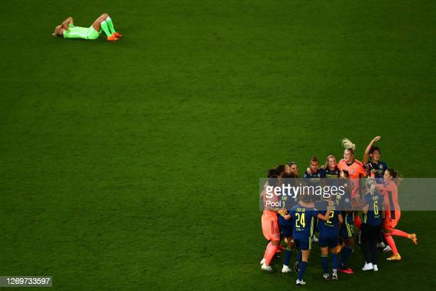 Olympique Lyon players celebrate following their team's victory in the UEFA Women's Champions League Final between VfL Wolfsburg Women's and...