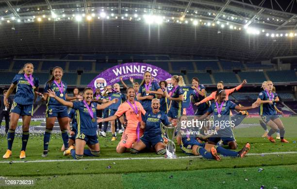 Olympique Lyon players celebrate with the UEFA Women's Champions League Trophy following their team's victory in the UEFA Women's Champions League...