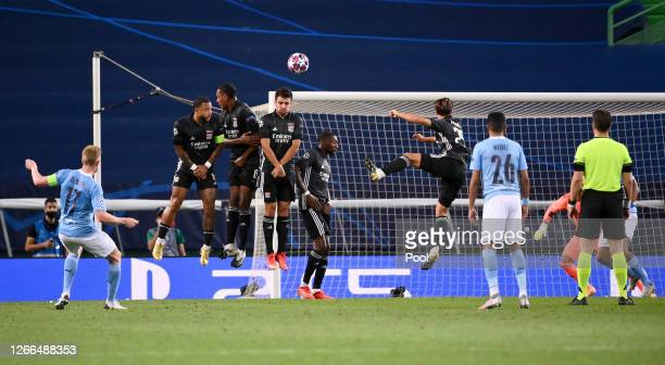 Olympique Lyon players jump as a wall to defend a Kevin De Bruyne of Manchester City free kick during the UEFA Champions League Quarter Final match...