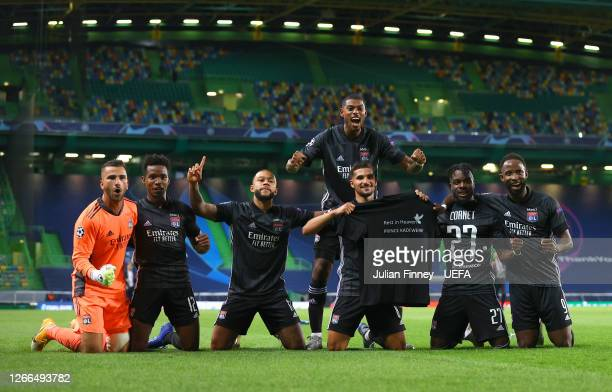Olympique Lyon players show respects for teammate Tino Kadewere, following the death of his brother, Prince Kadewere, as they celebrate following...