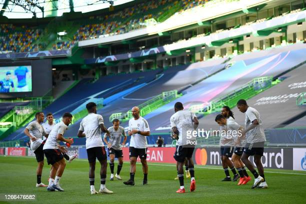 Olympique Lyon players warm up prior to the UEFA Champions League Quarter Final match between Manchester City and Lyon at Estadio Jose Alvalade on...