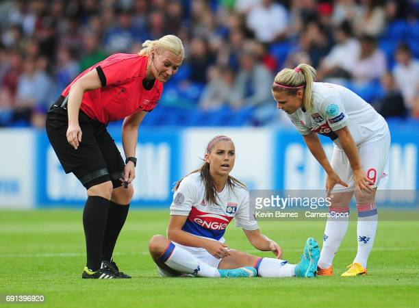 Olympique Lyonnais' Alex Morgan chats with the referee after picking up an injury during the UEFA Women's Champions League Final match between Lyon...