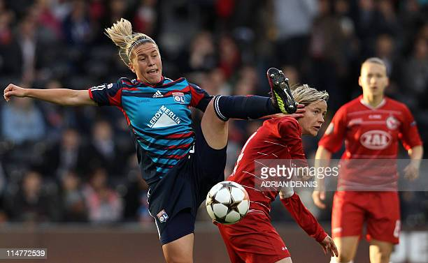 Olympique Lyonnais' Camille Abily vies for the ball against FFC Turbine Potsdam's Jennifer Zietz during their UEFA Women's Champions League final...