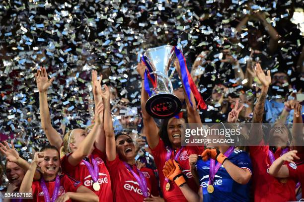 Olympique Lyonnais' captain Wendie Renard holds the trophy and celebrates with teammates after winning the UEFA Women's Champions League Final...