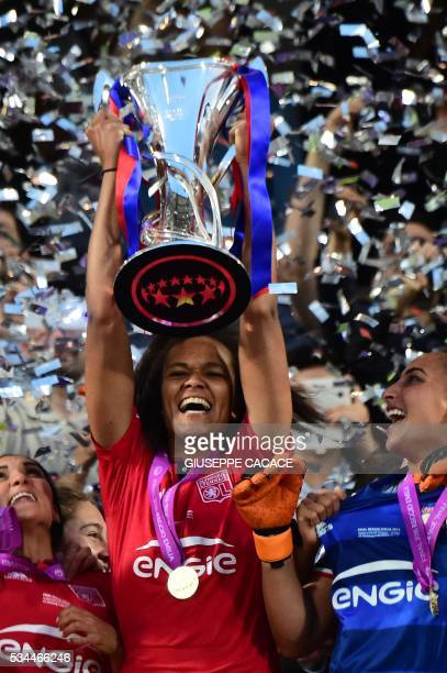 Olympique Lyonnais' captain Wendie Renard holds the trophy to celebrate with teammates after winning the UEFA Women's Champions League Final football...