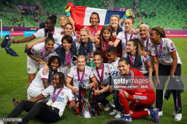 Olympique Lyonnais celebrate victory with the trophy after the UEFA Women's Champions League Final between Olympique Lyonnais v FC Barcelona Women at...